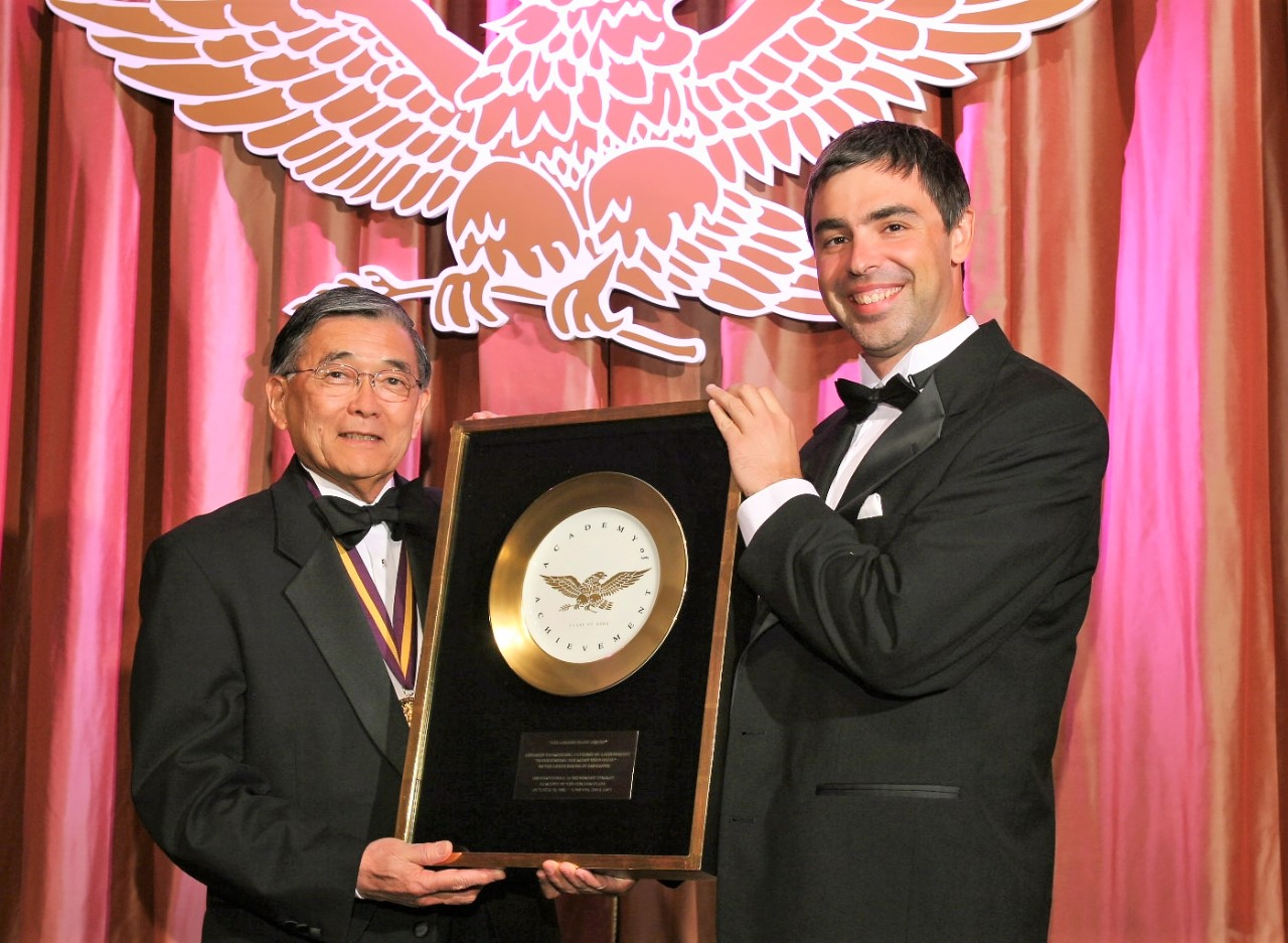 Awards Council member Larry Page presents the Golden Plate Award of the American Academy of Achievement to Norman Mineta