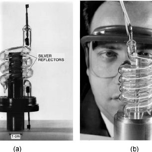 ͑ a ͒ Theodore Maiman's first laser, removed from aluminum cylinder used during operation, and ͑ b ͒ photo of Maiman behind a larger ruby laser, handed out at the Hughes press conference announcing the laser.