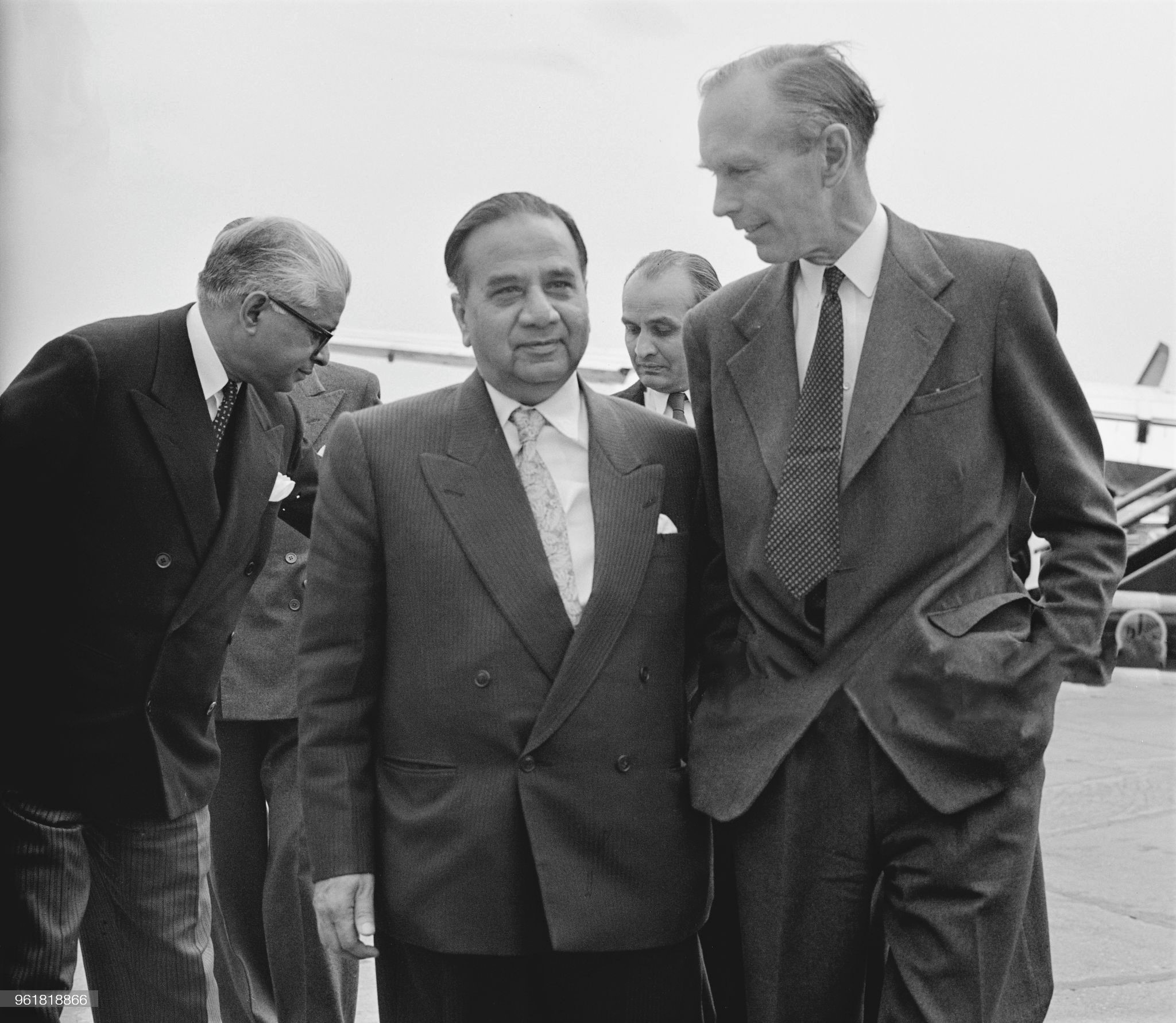 Huseyn Shaheed Suhrawardy (1892 - 1963), the Prime Minister of Pakistan, is met by Alec Douglas-Home (1903 - 1995, right), the Secretary of State for Commonwealth Relations, upon his arrival at London Airport, 24th June 1957. Suhrawardy is in the UK to attend the Commonwealth Prime Ministers' Conference which opens the next day, 24th June 1957.